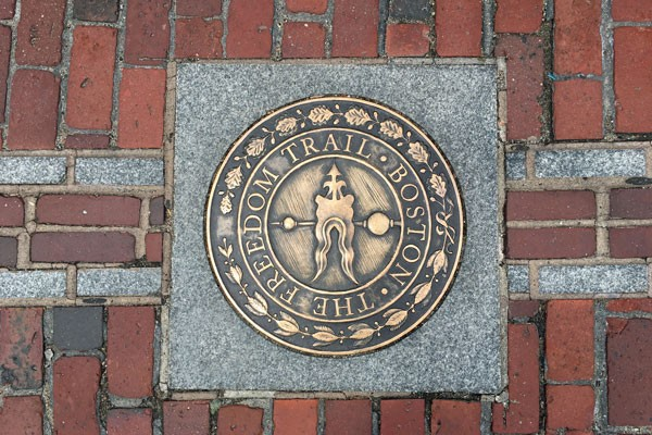 The Freedom Trail Boston metal sign inside the brick