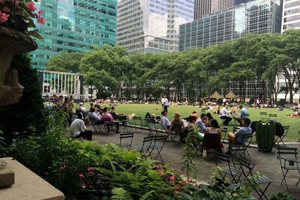 Bryant Park with people sitting on the lawn