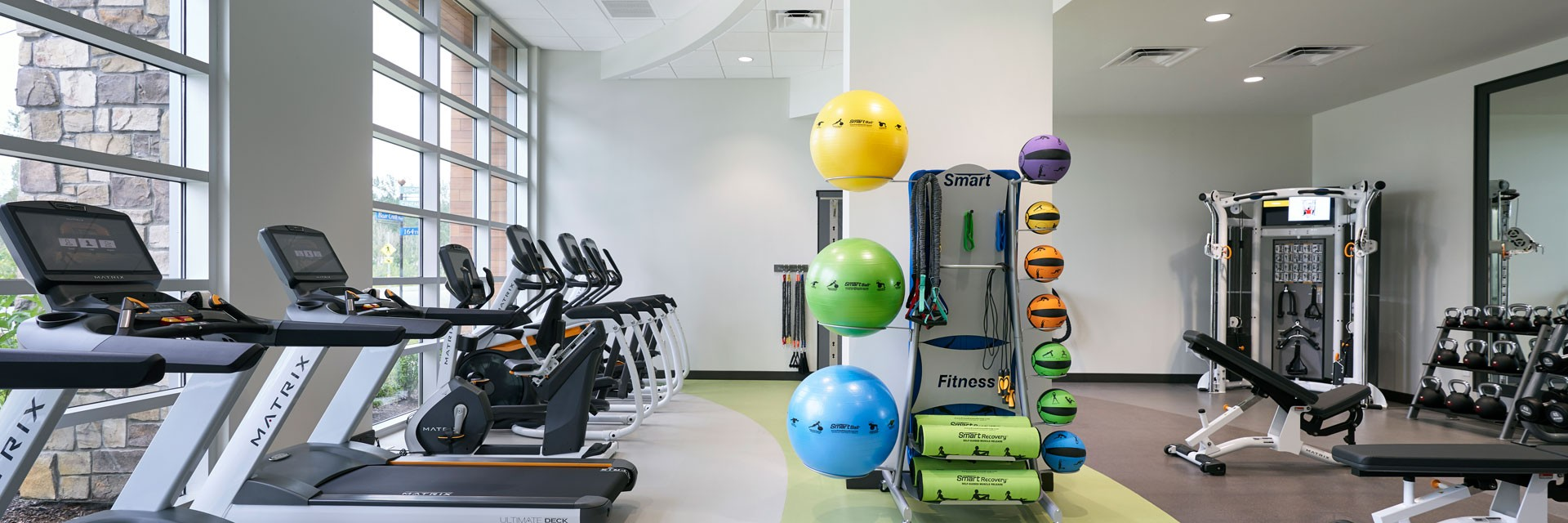 Archer Hotel Redmond - Fitness room with exercise equipment