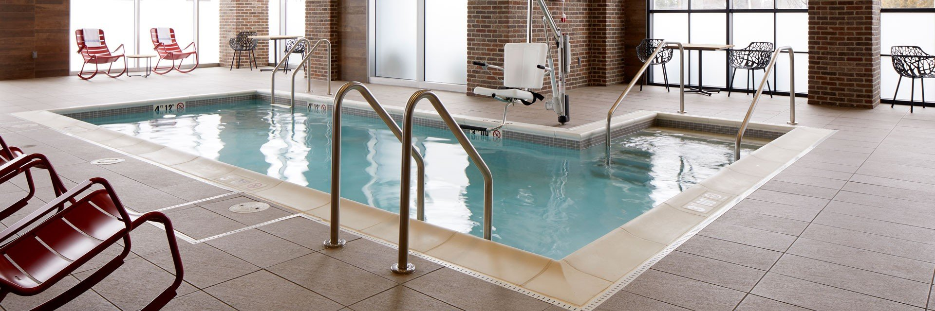 Archer Hotel Burlington pool with chairs