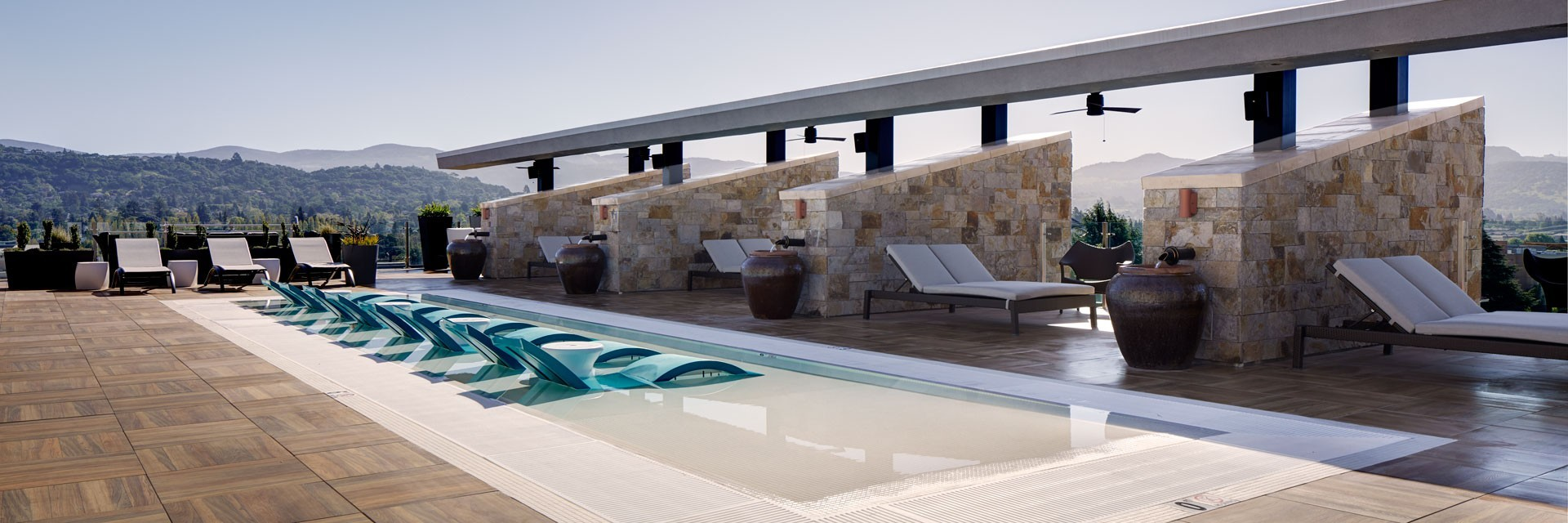 Archer Hotel Napa - rooftop water deck with cabanas and sky view