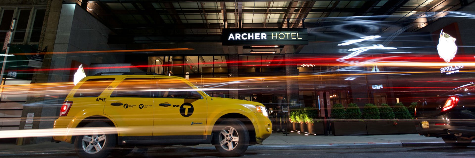 Cars passing in front of Archer Hotel New York's Entrance