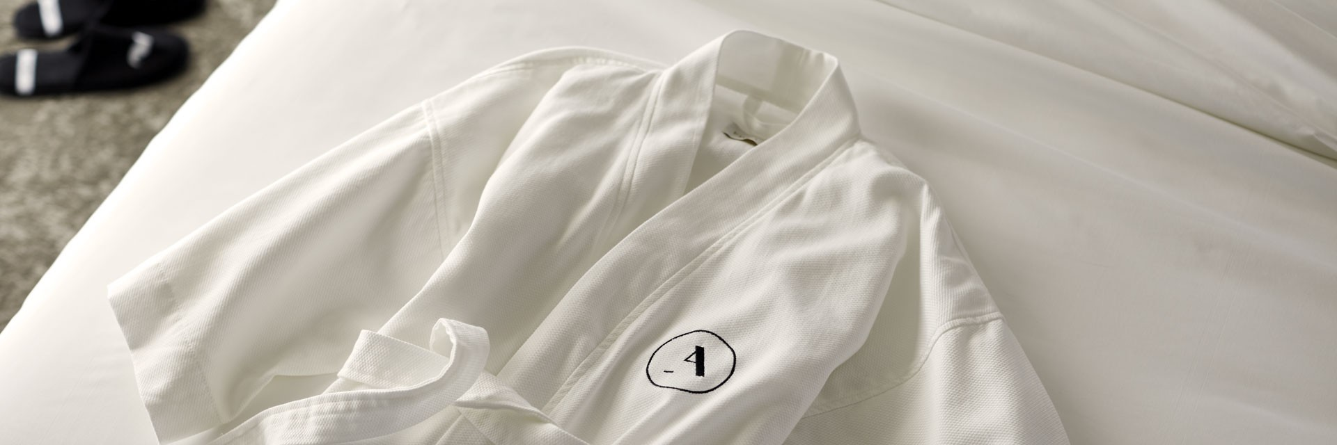 Archer Hotel Robe on the Bed