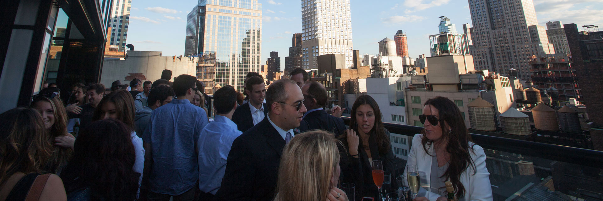 Spyglass Rooftop Bar Packed with People overlooking NYC