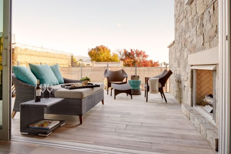 Archer's balcony experience with gas fireplace and lounge seating