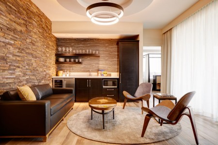 Archer's Den - separate living area with leather sofa, two chairs and a wet bar, no balcony