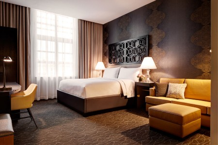 Deluxe King - spacious room with platform bed, workspace and sofa