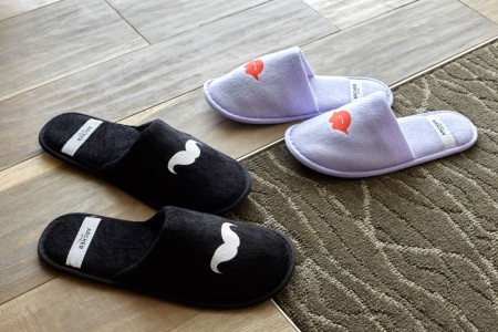 Archer's whimsical slippers with mustaches and lips