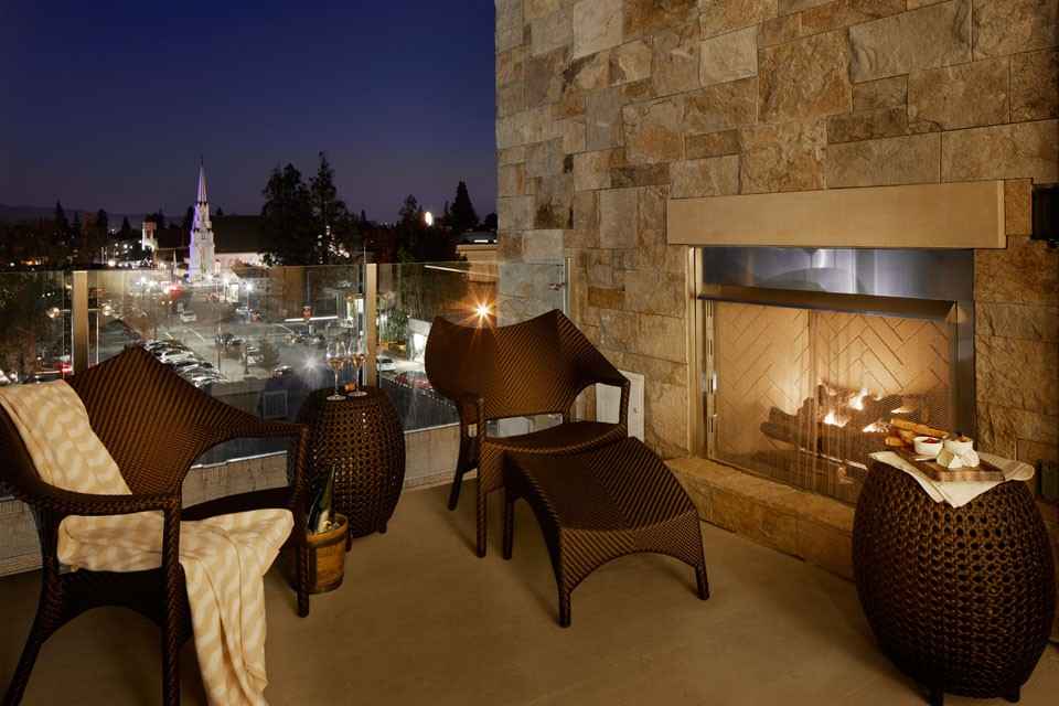 Archer Hotel Napa Archer's Den Hearing-Accessible Suite With Balcony + Fireplace — nighttime experience overlooking downtown Napa