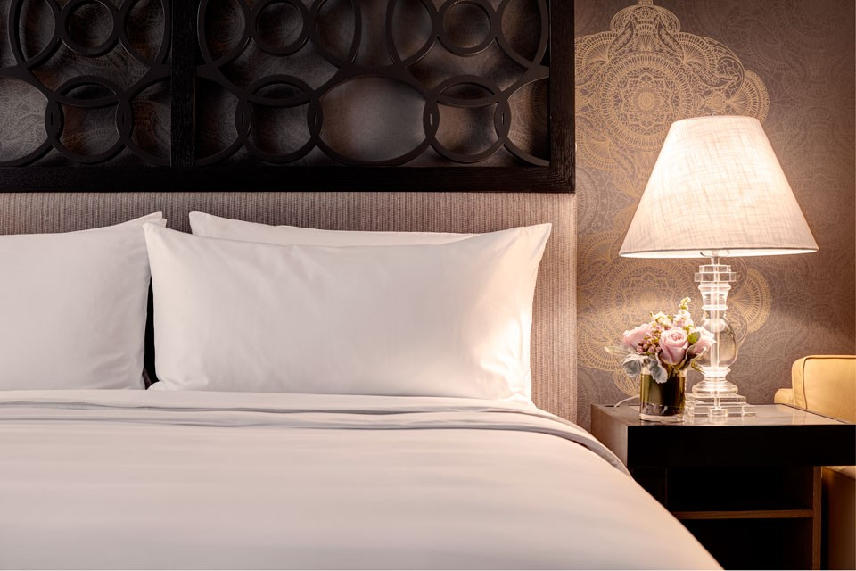 Archer Hotel Napa Deluxe King Guest Room — bed and nightstand