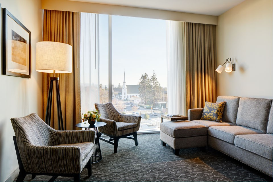 Archer Hotel Napa Double King Hearing-Accessible Guest Room — living area with floor-to-ceiling windows