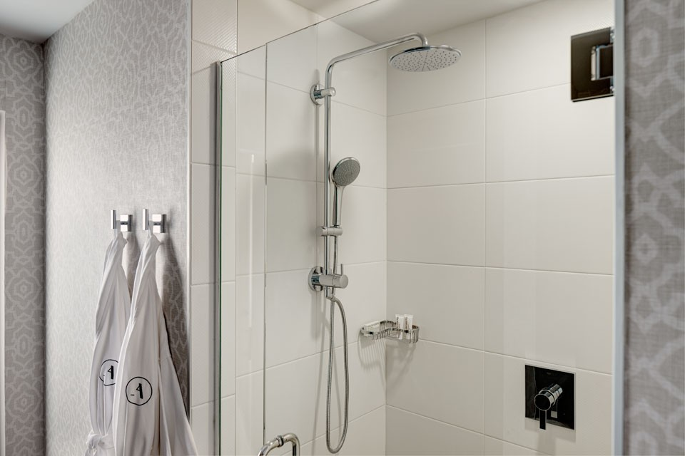 Archer Hotel Napa Double King Mobility-Accessible Guest Room With Roll-in Shower — tile shower and Frette bathrobes