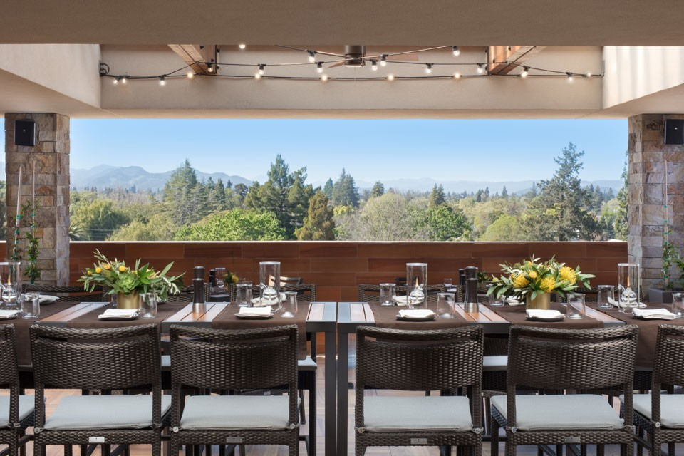 Archer Hotel Napa - Sky & Vine table seating with flowers and silverware