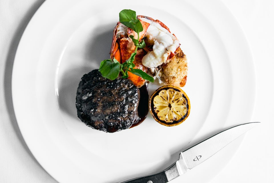 Archer New York Hotel Charlie Palmer Steak Surf Turf (Lobster and Steak) with grilled lemon