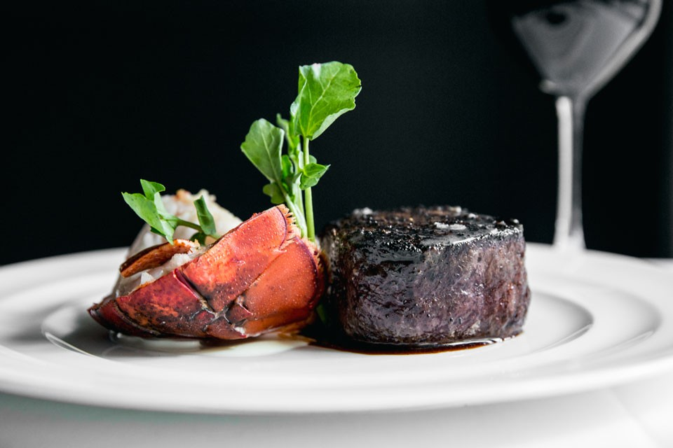 Archer New York Hotel Charlie Palmer Steak Surf and Turf - Lobster Tail with Petite Filet and a glass of wine