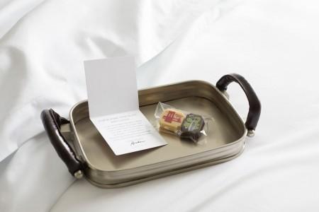 Nightly turndown treats — Lilac Chocolates on a tray with a card