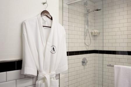 White Frette robe hanging near shower
