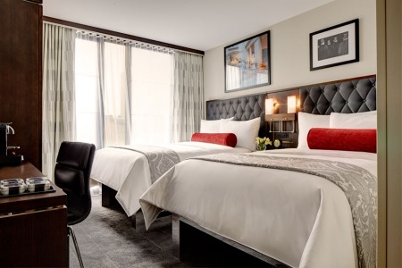 Double Double - two platform beds with five-star bedding and floor-to-ceiling windows
