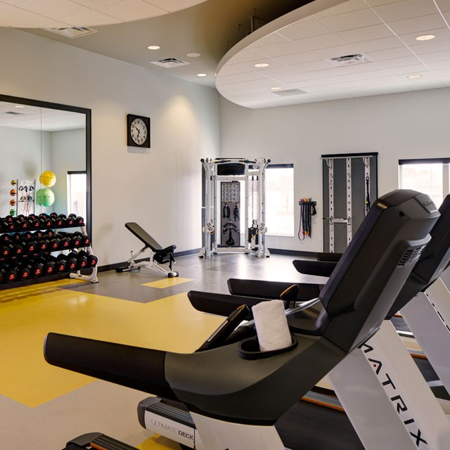 Fitness studio treadmill and weights