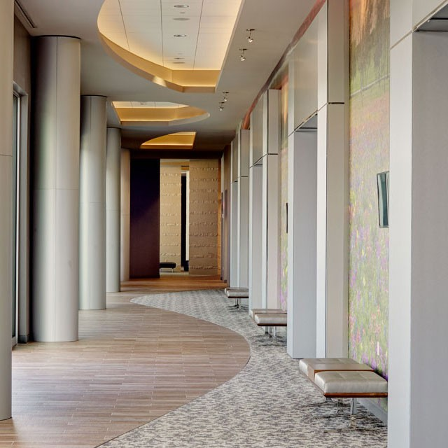 Prefunction space — long, naturally lit hallway — at Archer Hotel Austin