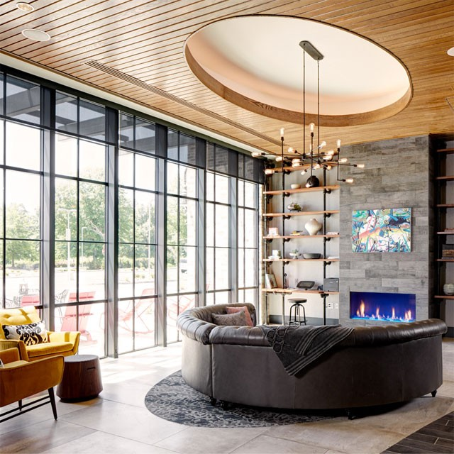 Archer Hotel Florham Park lobby with sofa and fireplace