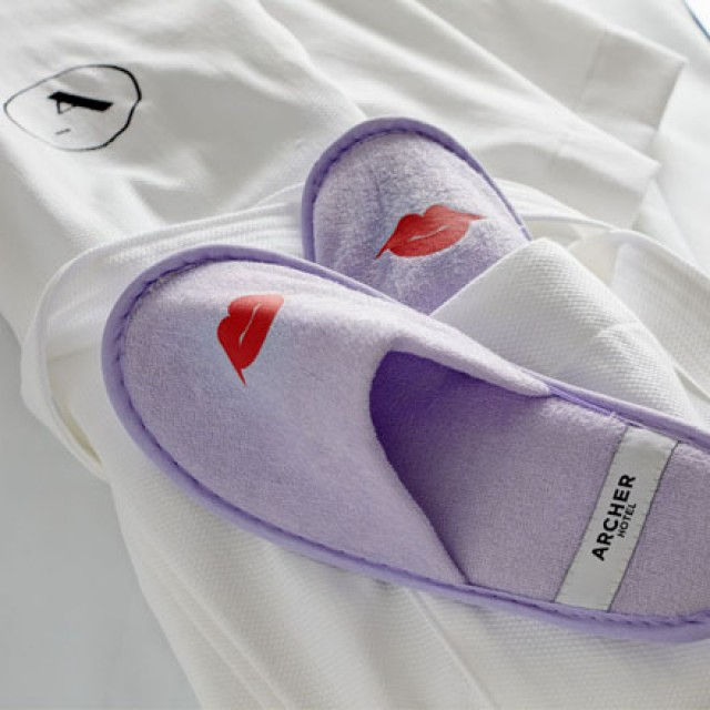 Archer Hotel white robe and lavender slippers
