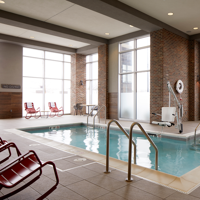 Archer Hotel Burlington - Indoor Pool with red rocking chairs