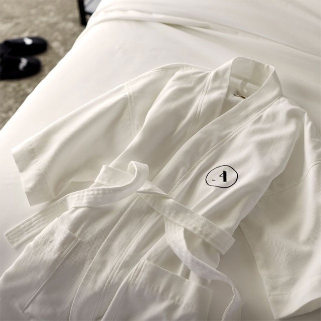 White robe on bed