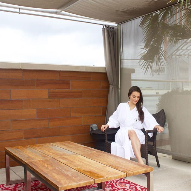 woman in white robe relaxing in a spa-like atmosphere