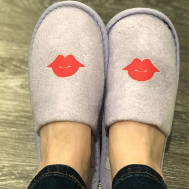 Closeup of Archer's lavender slippers