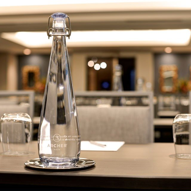 Archer Hotel Napa - Meeting table with water