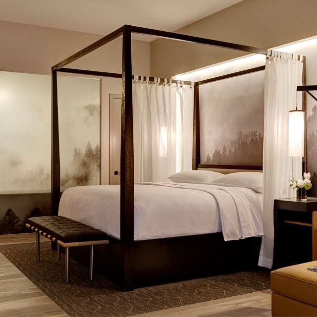 Archer Hotel Napa - Guest room suite four-poster bed with trees and fog mural