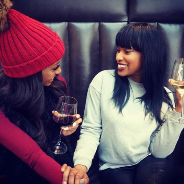 Two women sitting and enjoying wine