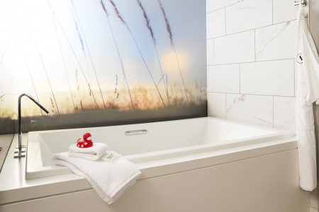 Archer's Den - large soaking tub with bath salts and a rubber duck