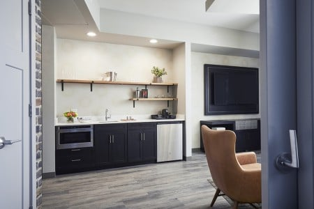 Archer's Den - fully stocked wet bar and wall-mounted TV in the living area
