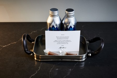 Welcome amenity of complimentary water, handmade salted caramels and card