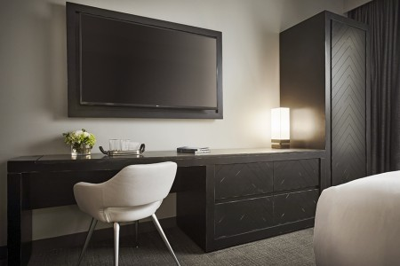 Classic King - oversized desk with modern white chair and flat-screen TV