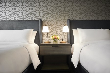 Double King - bedding detail with a custom nightstand and a starburst metallic accent wall